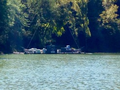 Cable-guided paddle wheel ferry system in front of us carries three cars at a time over the Green River.
