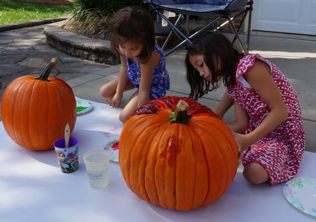 We don't carve our pumpkins, we PAINT 'em!