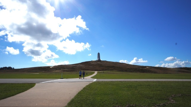 Looking uphill at the memorial Wright Bros obelisk